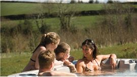 Family relaxing in a hot tub